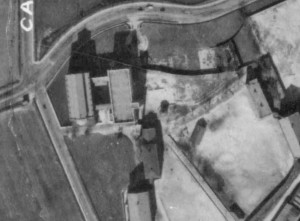 Aerial View Of St. Mary's Circa 1927, Showing Chapel and Four Story Stone Building Fronting Wilkins Avenue (Maryland Port Administration Aerial Photo - image located at jscholarship.library.jhu.edu)